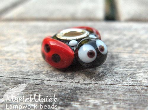Lampwork glass ladybird bead by Marie Kuniek Van Esveld